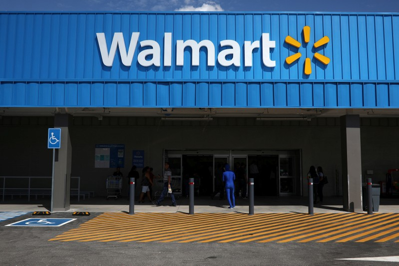 FILE PHOTO: The logo of Walmart is seen outside of a new Walmart Store in San Salvador