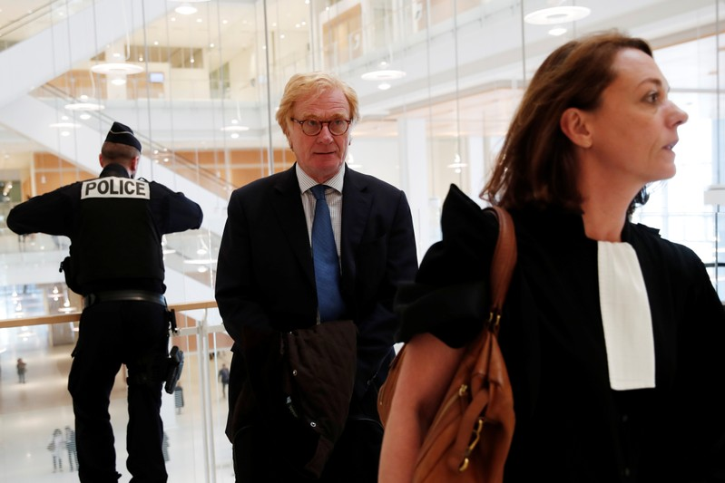 Former general director of UBS France, Patrick de Fayet, arrives at the Paris courthouse prior to the Swiss banks trial in Paris