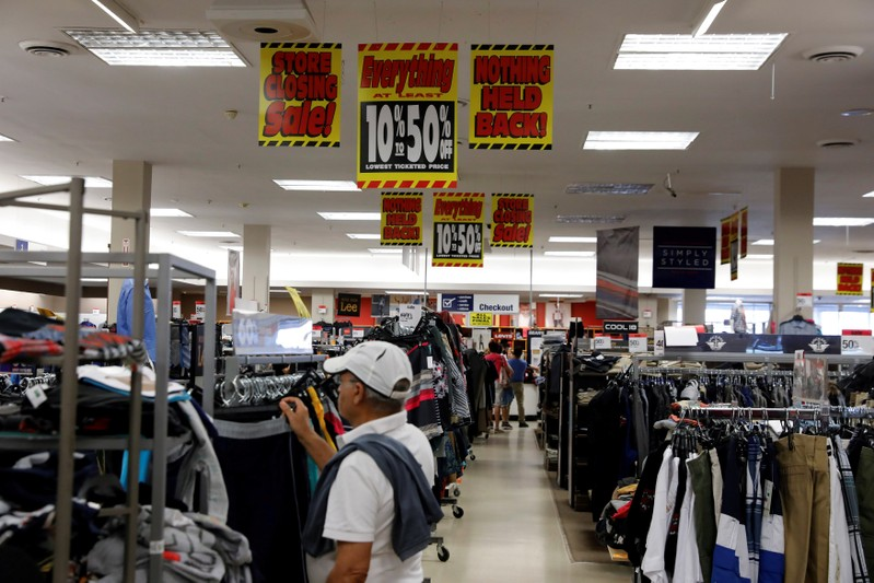 FILE PHOTO: Store closing signs advertising discounts at a Sears in New Hyde Park, New York