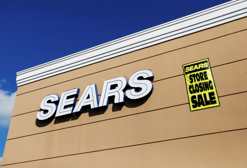 FILE PHOTO:    A store closing sale sign is posted next to a Sears logo in New Hyde Park, New York