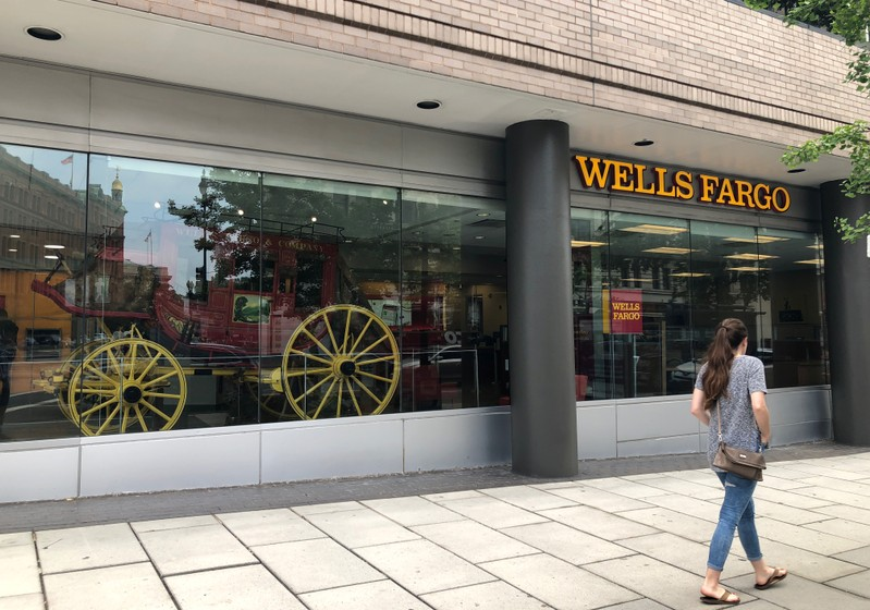 A lady walks by a Wells Fargo bank branch in Washington