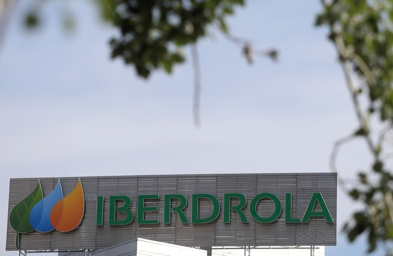 The logo of Spanish utility company Iberdrola is seen outside its headquarters in Madrid