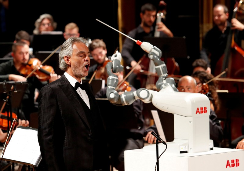 FILE PHOTO: Humanoid robot YuMi conducts the Lucca Philharmonic Orchestra performing a concert alongside Italian tenor Andrea Bocelli at the Verdi Theatre in Pisa