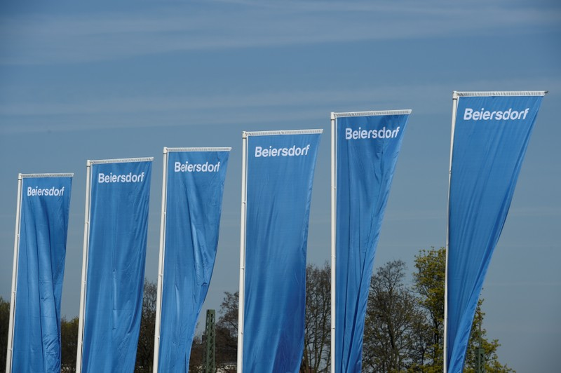 Flags of German personal-care company Beiersdorf are pictured at the annual shareholders meeting in Hamburg