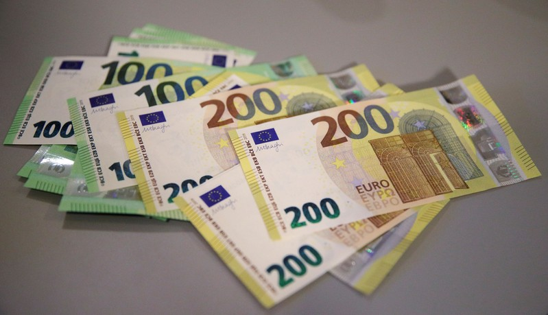 FILE PHOTO: New 100 and 200 euro banknotes are displayed in Vienna