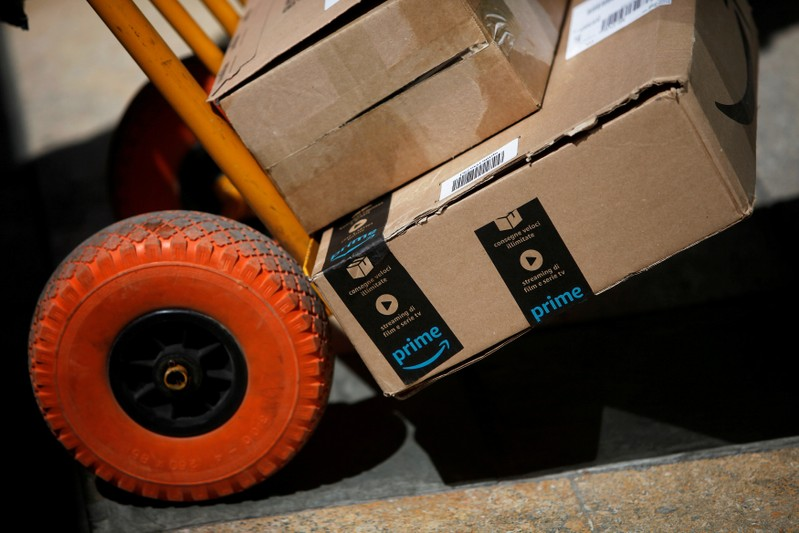 FILE PHOTO: An Amazon box is seen on a cart before being delivered by a Correos Express delivery worker in downtown Ronda