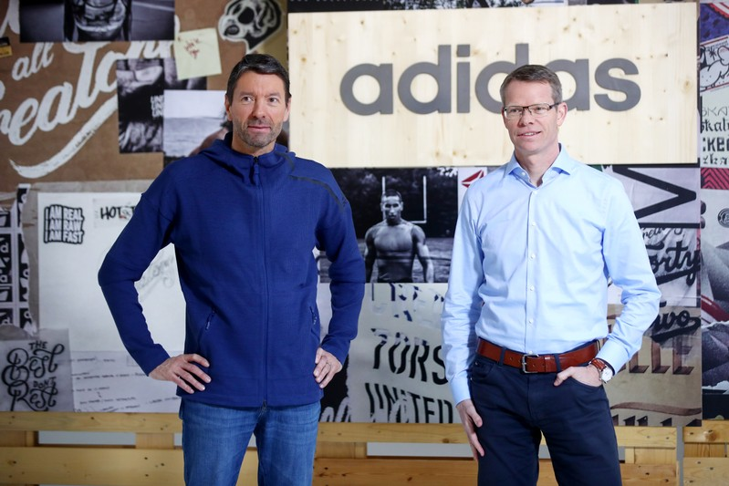 Adidas CEO Rorsted and CFO Ohlmeyer pose before the company's annual news conference in Herzogenaurach
