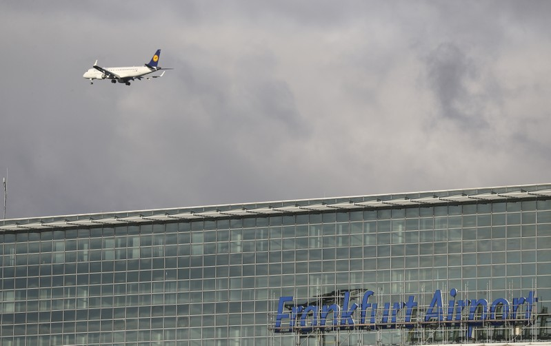 An aircraft of German air carrier Lufthansa flies beyond the a terminal at the Fraport airport in Frankfurt