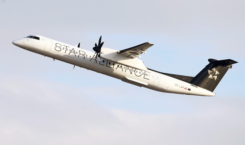 Austrian Airlines Bombardier Dash 8 Q400 aircraft in Star Alliance livery takes off from Zurich Airport
