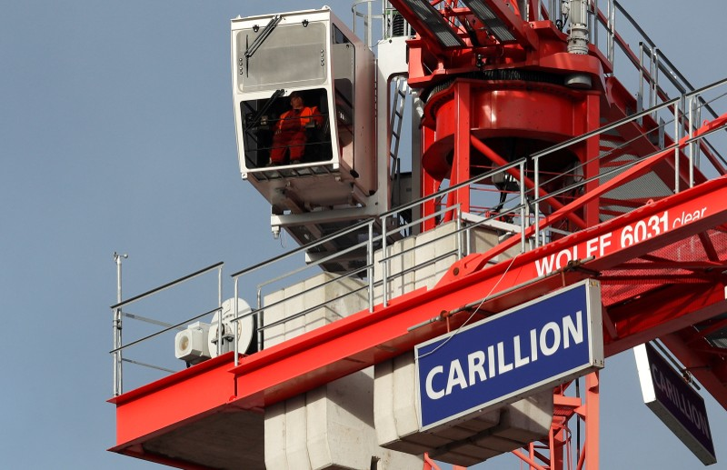 FILE PHOTO: A worker operates a crane on Carillion's Midland Metropolitan Hospital construction site in Smethwick