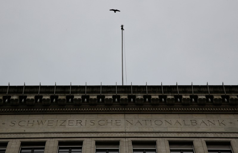 Bird flies over the building of the Swiss National Bank in Zurich