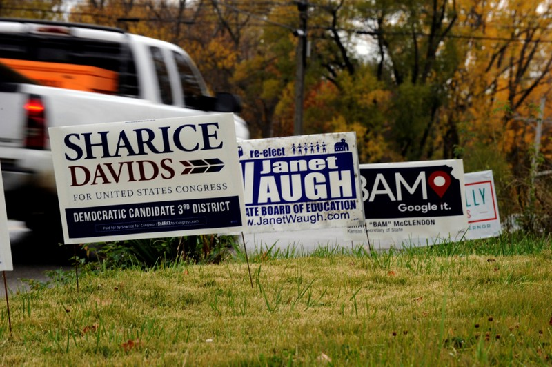 FILE PHOTO: A campaign sign for Kansas Third District U.S. Representative Sharice Davids is seen among others supporting Kansas Democrats for the midterm elections in Kansas City, Kansas