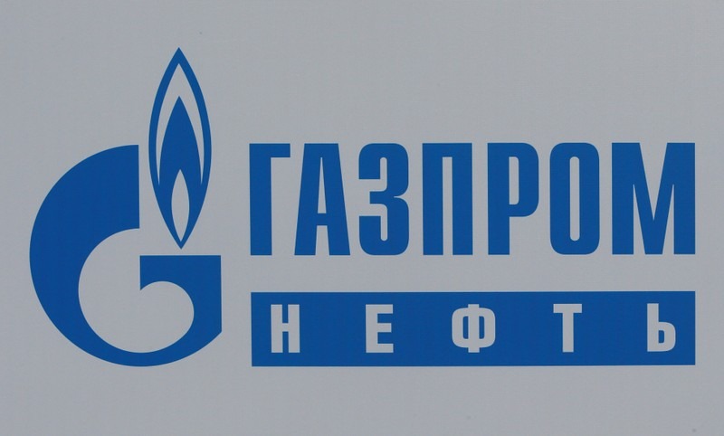 FILE PHOTO: The logo of Russia's oil producer Gazprom Neft is seen on a board at the SPIEF 2017 in St. Petersburg