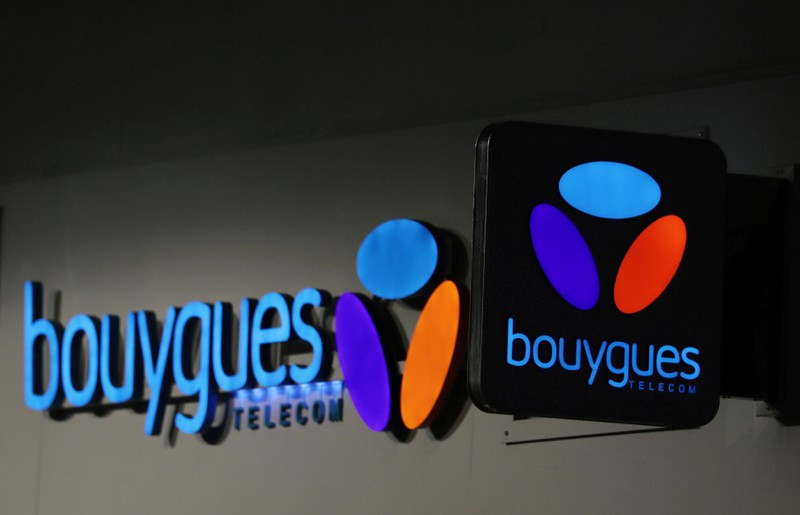 FILE PHOTO: The logo of Bouygues Telecom is seen at the entrance of a shop in Nice