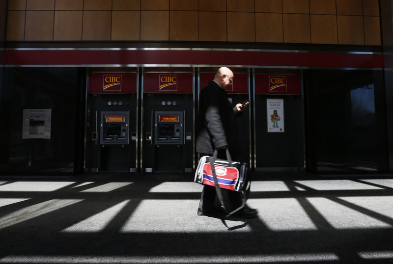 A pedestrian walks past the CIBC ATM machines in  Montreal