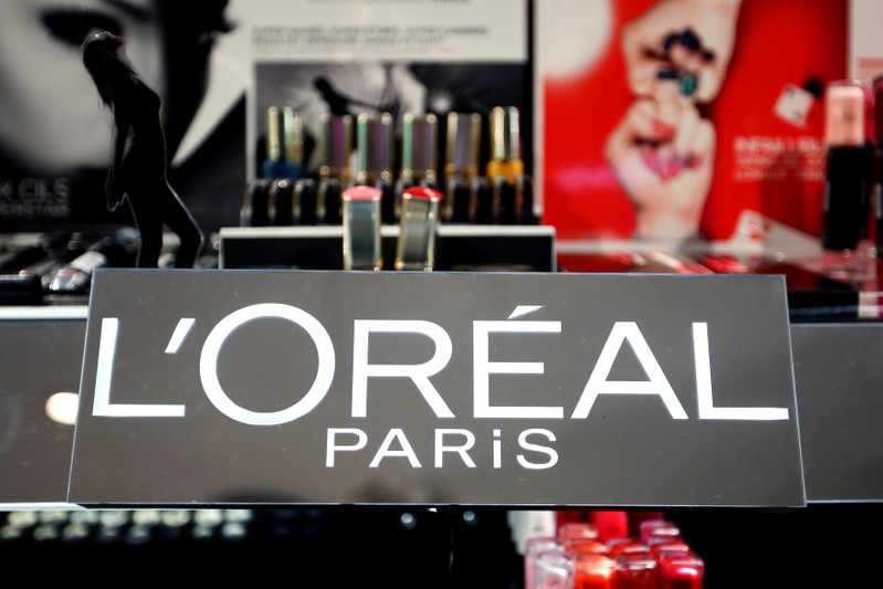 FILE PHOTO: The logo of French cosmetics group L'Oreal is seen on a sales counter at a department store in Paris