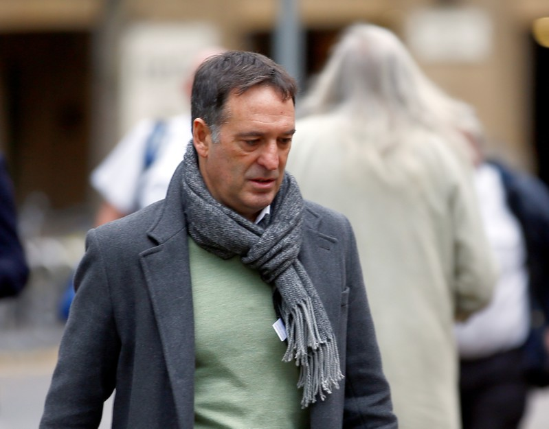 Former Tesco executive Christopher Bush arrives at Southwark Crown Court in London