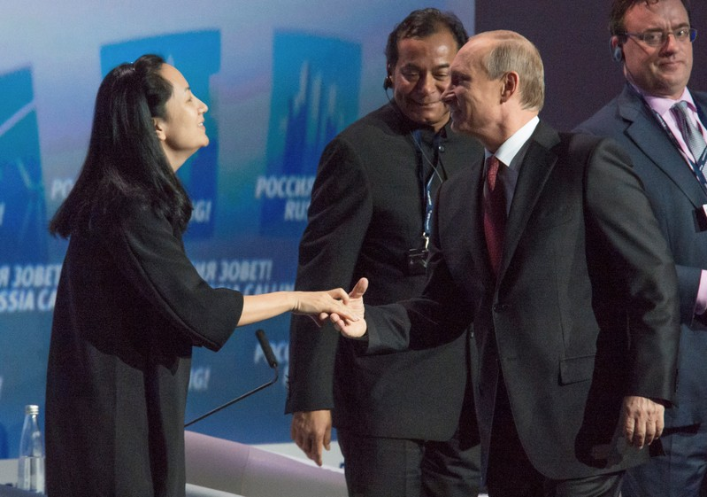 FILE PHOTO:  Russia's President Vladimir Putin and Huawei's Executive Board Director Meng Wanzhou attend the VTB Capital Investment Forum