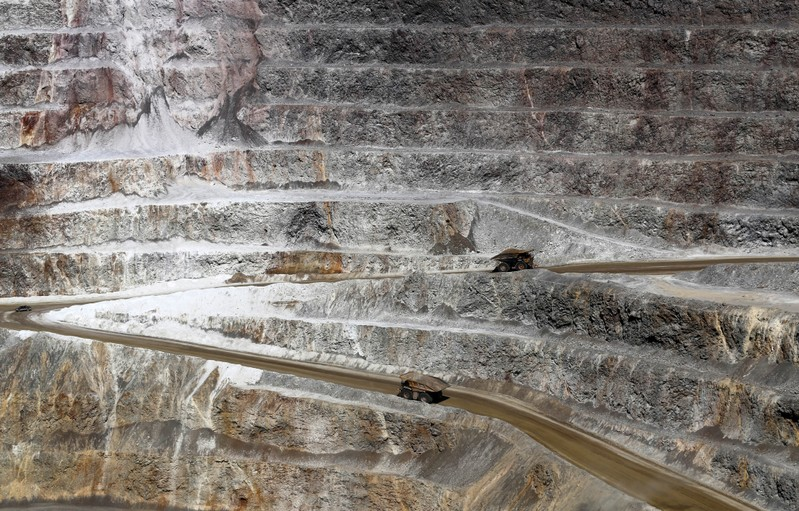 Dump trucks carrying minerals operate at Barrick Gold Corp's Veladero gold mine in Argentina's San Juan province