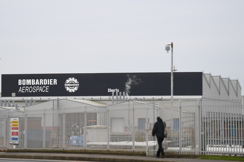 FILE PHOTO: A man walks past the Bombardier plant in Belfast