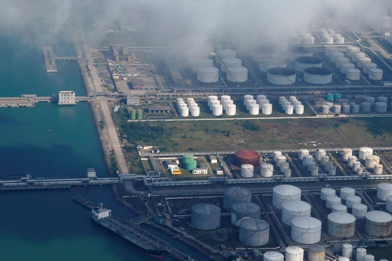 Oil and gas tanks are seen at an oil warehouse at a port in Zhuhai