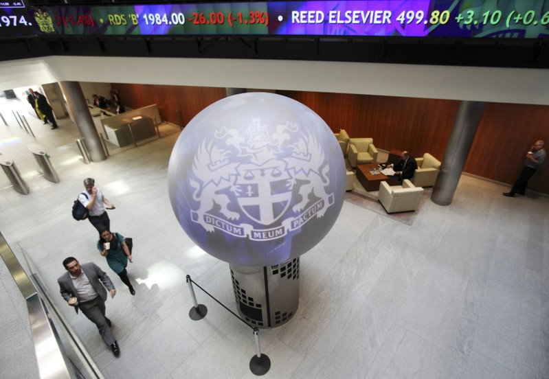 FILE PHOTO: People walk through the lobby of the London Stock Exchange