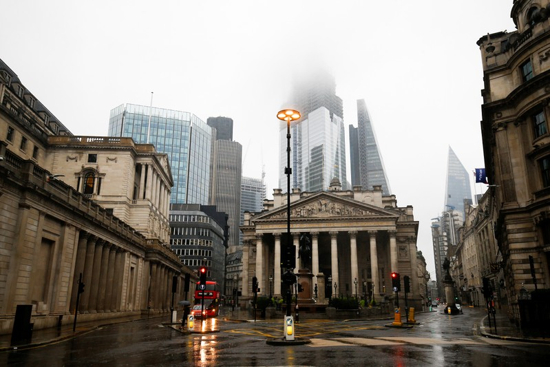 The Bank of England is seen in the financial district during rainy weather in London