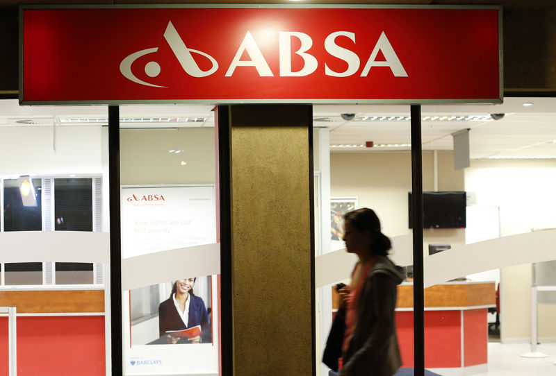 A woman walks past a branch of Barclay's South African subsidiary Absa bank in Cape Town