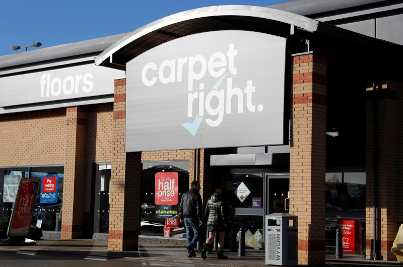 Customers enter a Carpetright store in Derby