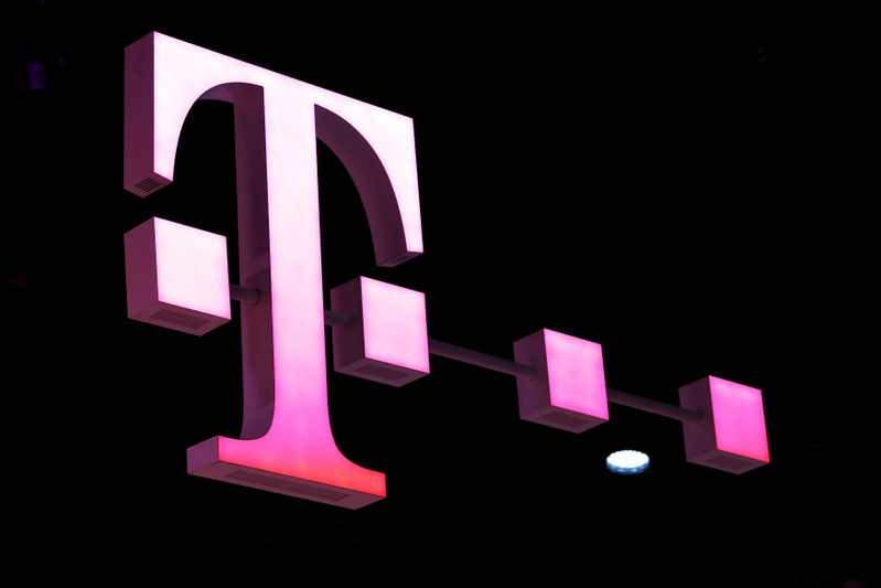 FILE PHOTO: A Deutsche Telekom logo at the Mobile World Congress in Barcelona