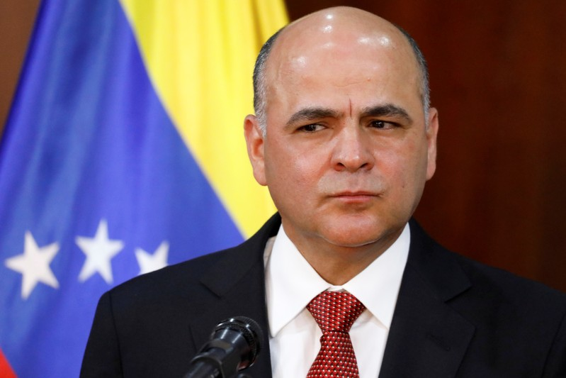FILE PHOTO: Venezuela's Oil Minister and President of PDVSA Manuel Quevedo pauses while he talks to the media during a news conference in Caracas