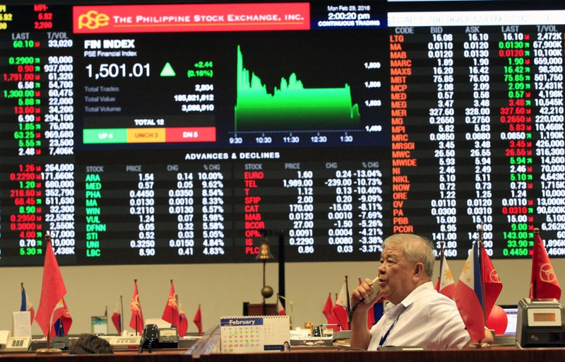 A stockbroker speaks on the phone inside the Philippine Stock Exchange (PSE) in Makati city, metro Manila