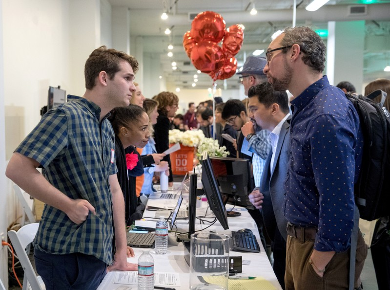 FILE PHOTO: Job seekers and recruiters gathered at TechFair in Los Angeles