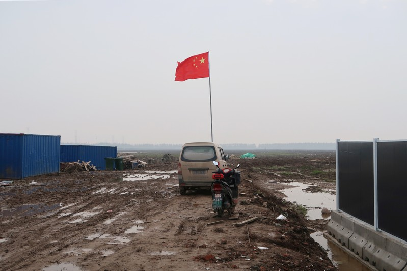 Chinese flag is seen on the land secured by Tesla for its Gigafactory in Shanghai