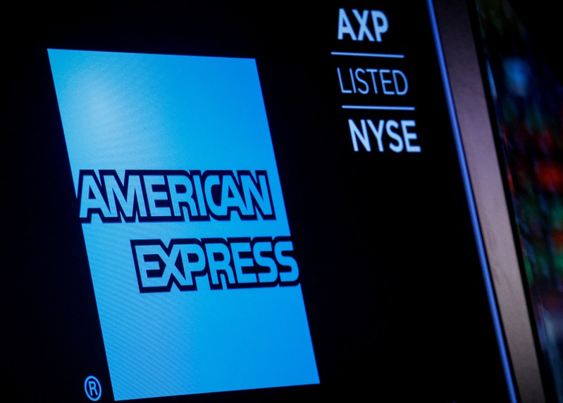 FILE PHOTO: American Express logo and trading symbol are displayed on a screen at the NYSE in New York