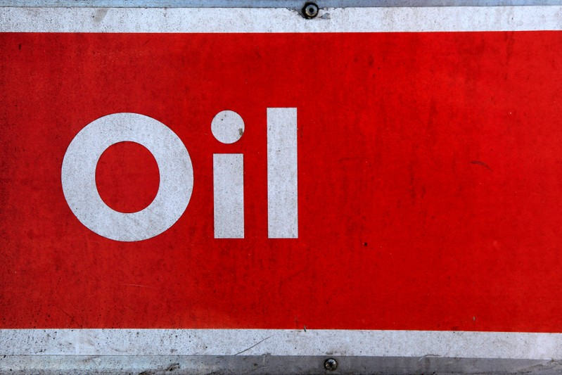 FILE PHOTO: The word oil is pictured on an oil bank at a recycling yard in London, UK