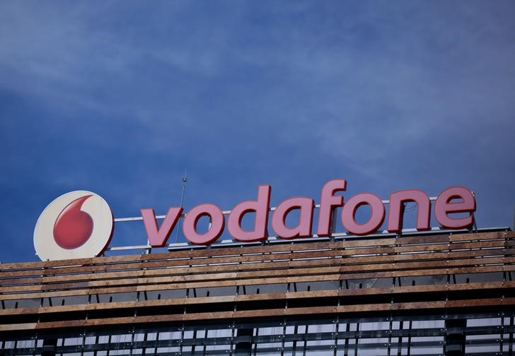 The Vodafone logo can be seen on top of a building outside Madrid, Spain