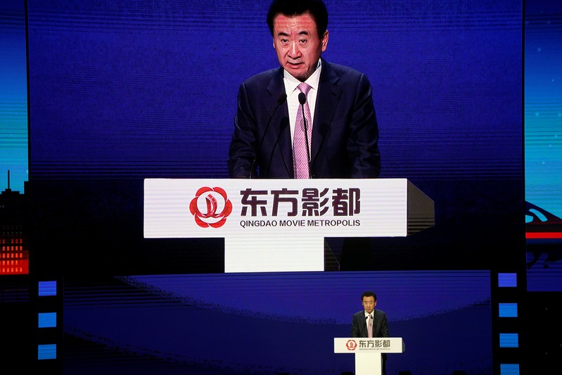 Wang Jianlin, chairman of Chinese property developer Dalian Wanda Group, attends the opening ceremony of Qingdao Oriental Movie Metropolis in Qingdao