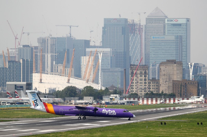 FILE PHOTO: A Flybe Bombardier Dash 8 Q400 airplane taxis at City Airport in London