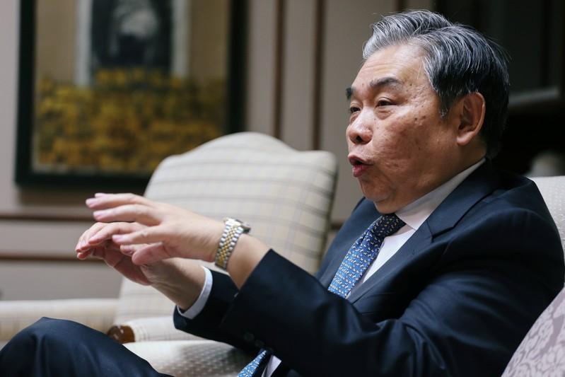 Apisak Tantivorawong, Thailand's Finance Minister gestures during an interview with Reuters at the Finance Ministry, in Bangkok
