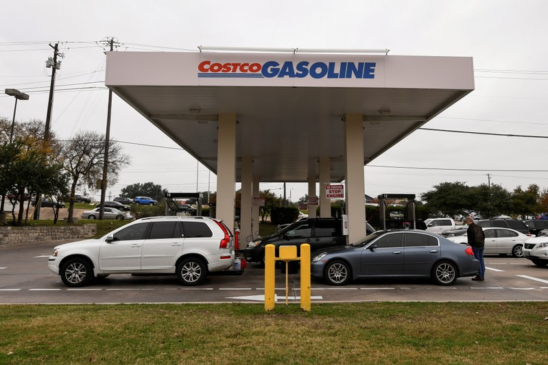 FILE PHOTO: Customers line up at a Costco gasoline station in Austin