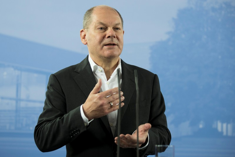 German Finance Minister Olaf Scholz attends a press conference after the federal cabinet meeting in Potsdam