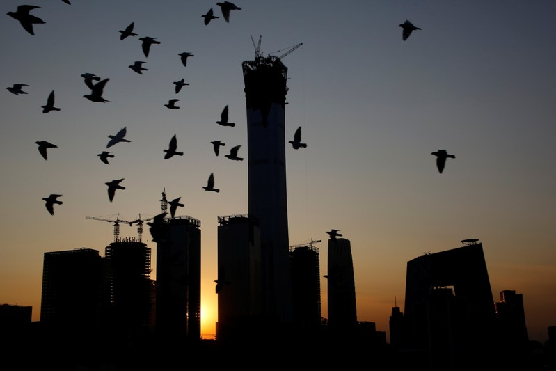 The sun sets behind the Central Business District with the CITIC Tower at it's centre in Beijing