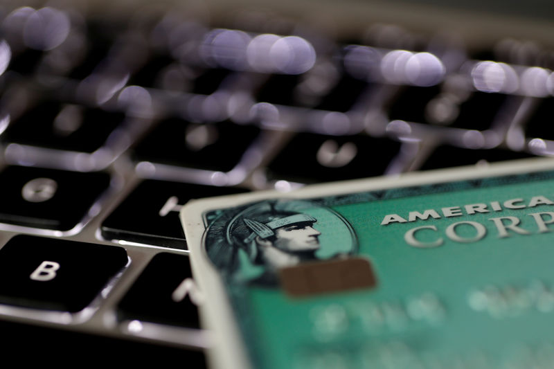 An American Express credit card is seen on a computer keyboard in this picture illustration