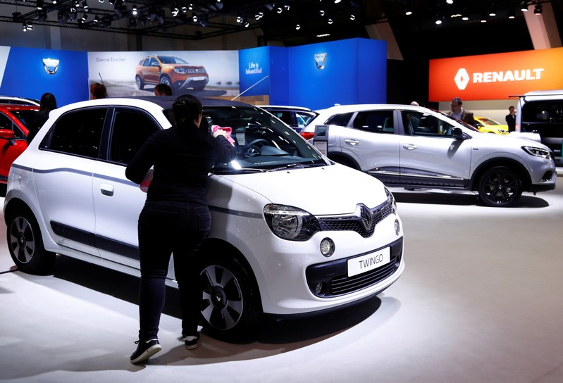 A worker cleans a Renault Twingo car at Brussels Motor Show