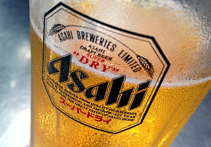 Condensation collects on a glass of Asahi beer at a bar in Singapore