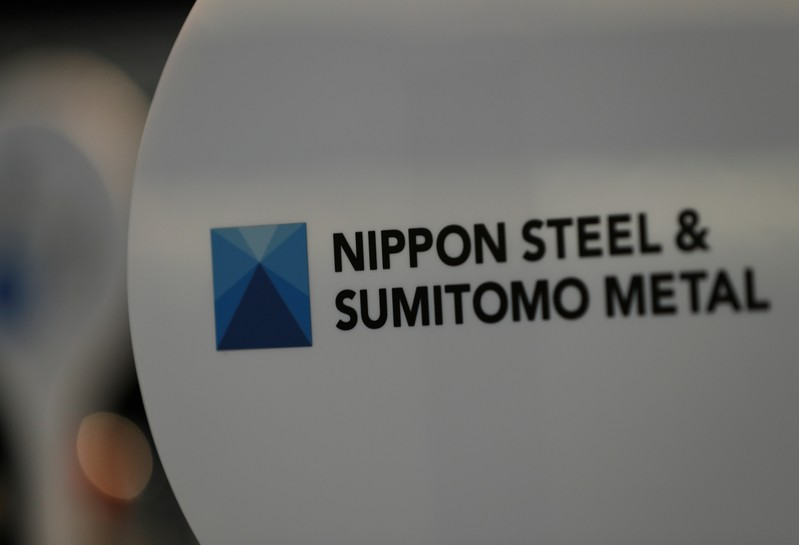 FILE PHOTO - The logo of Nippon Steel & Sumitomo Metal Corp.'s Kimitsu steel plant is pictured at its exhibition hall in Kimitsu