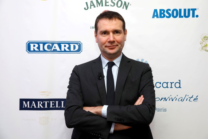 FILE PHOTO: Alexandre Ricard, Chairman and CEO of French drinks maker Pernod Ricard, poses before a news conference to present the company's first-half earnings in Paris
