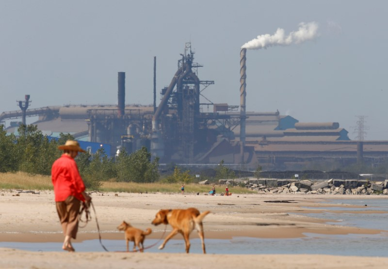 FILE PHOTO: A woman walks her dogs along the lake front at Marquette Park in Gary Indiana
