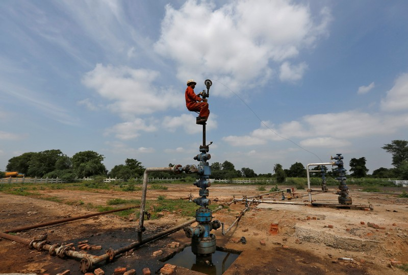 A technician works inside the Oil and Natural Gas Corp (ONGC) group gathering station on the outskirts of Ahmedabad